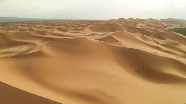 sunset over the sand dunes in the desert. aerial view - sand dune stock videos & royalty-free footage