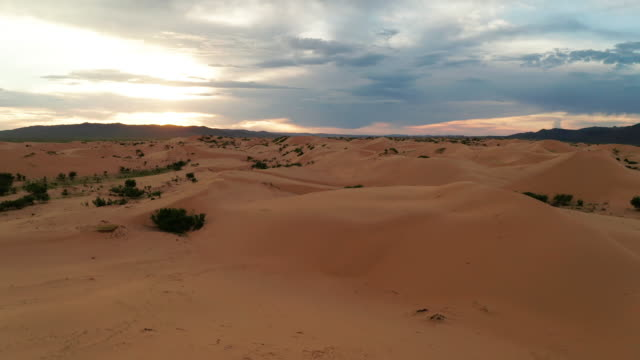 sunset over the sand dunes in the desert. aerial view - sandy utah stock videos and b-roll footage