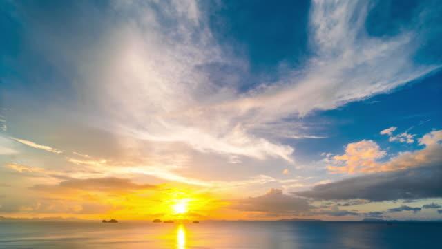 海 4 k の時間の経過に沈む夕日 - 星型点の映像素材/bロール