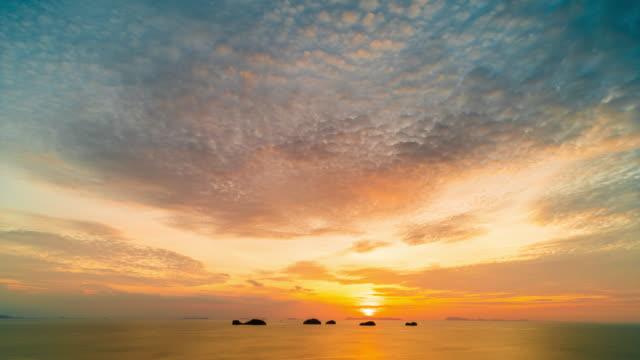 sunset over the sea - day and night image series stock videos & royalty-free footage