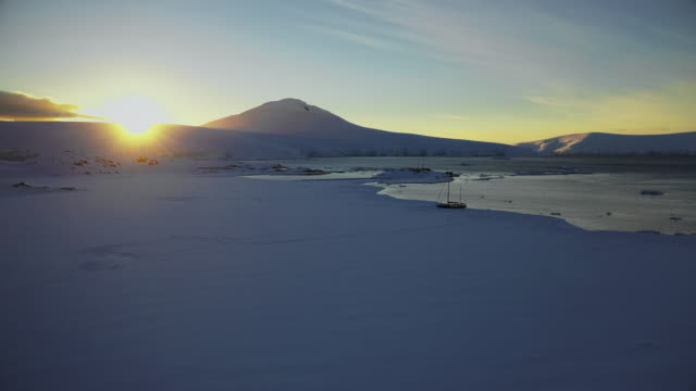sunset over the snowcapped mountains near port lock roy, antarctica - antarctica drone stock videos & royalty-free footage