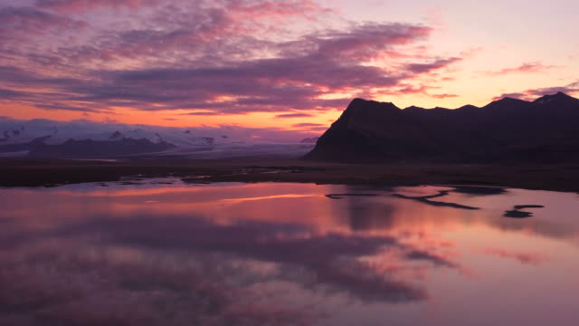sunset over the south coast of iceland near jokulsarlon - jokulsarlon stock-videos und b-roll-filmmaterial