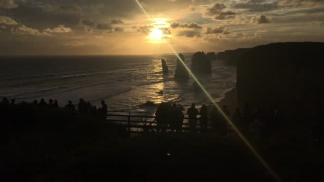 sunset over the twelve apostles at port campbell national park great ocean road in victoria australia - port campbell national park stock videos & royalty-free footage