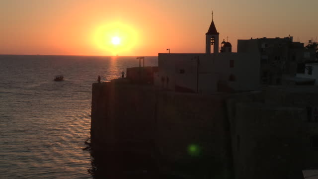 sunset over the wall, akko, israel - akko stock videos and b-roll footage