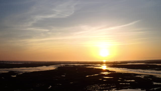sunset over tidal mud flats - soil stock videos & royalty-free footage