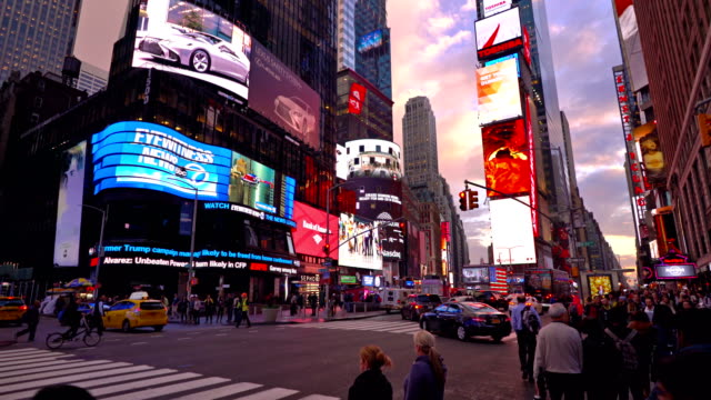 sunset over time square - billboard stock-videos und b-roll-filmmaterial