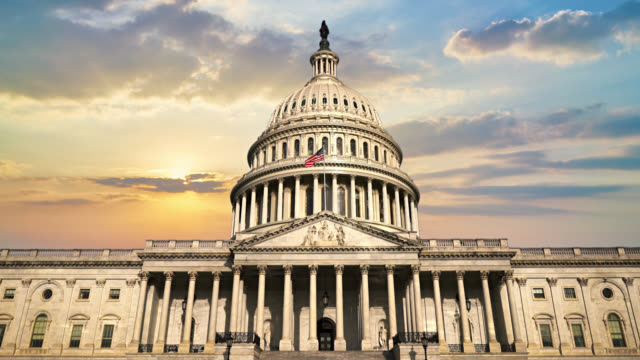 sunset over united states capitol. - united states congress stock videos & royalty-free footage