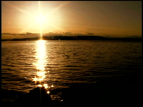 sunset over water, puget sound, tacoma, washington - puget sound stock videos & royalty-free footage