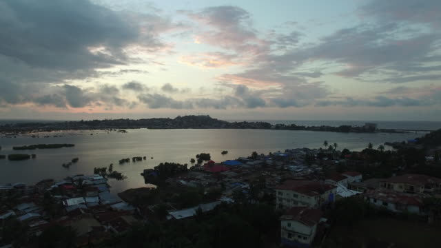 drone: sunset over water - sierra leone stock videos & royalty-free footage