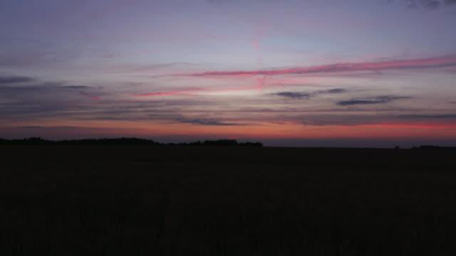 Sunset over wheatfields in France Timelapse