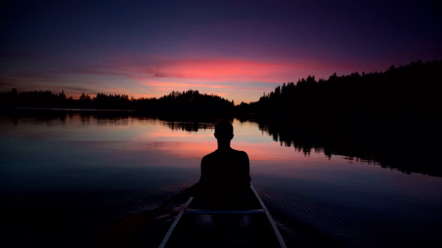sunset paddle - canoeing stock videos and b-roll footage