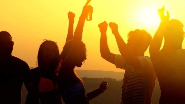 sunset party. - trinken stock-videos und b-roll-filmmaterial