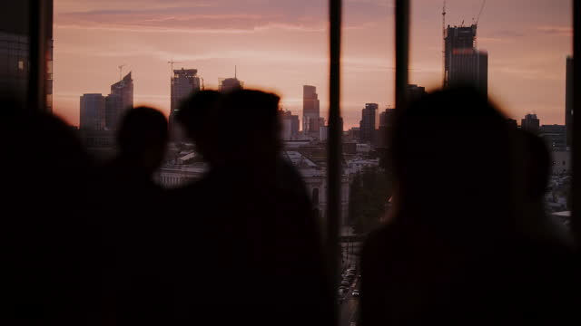 sunset party with city view. people looking at view - arms raised stock videos & royalty-free footage