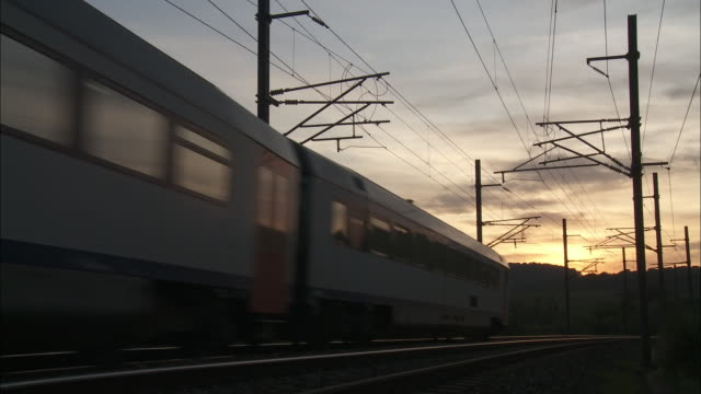 sunset - passenger train - passenger train stock videos & royalty-free footage