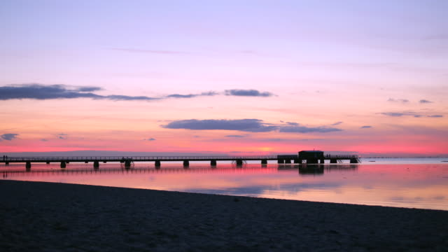 sunset pier view from beach - malmo stock videos and b-roll footage