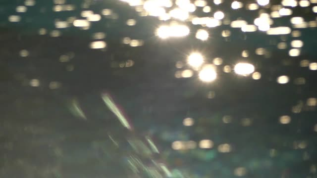 sunset reflection in swimming pool - defocussed stock videos & royalty-free footage