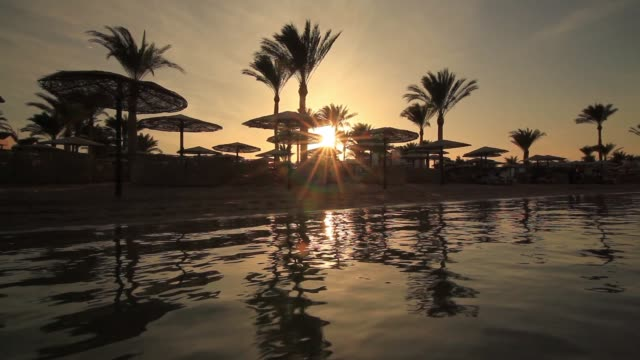 sunset reflection in the water on the beach. egypt - hurghada stock-videos und b-roll-filmmaterial