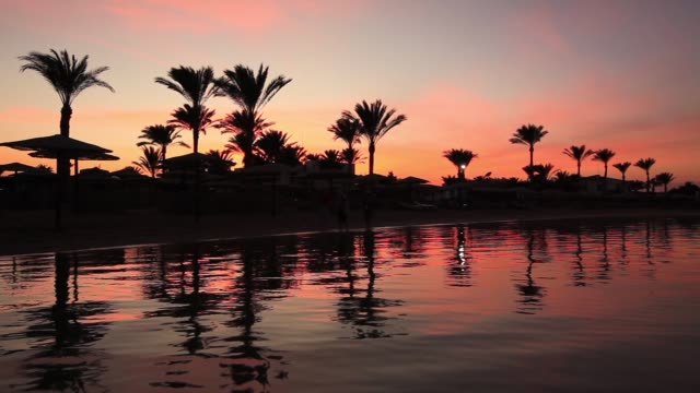 Sunset reflection in the water on the beach. Egypt