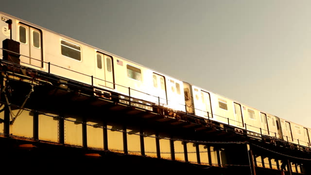 sunset reflection of the 7 train in sunnyside queens - elevated train stock videos & royalty-free footage