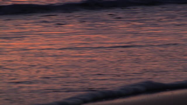 sunset reflections on the sand - artbeats stock videos & royalty-free footage