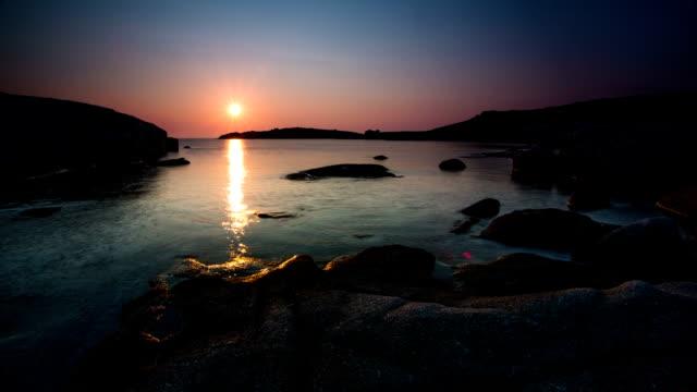 time lapse: sunset rocky coastline - rocky coastline stock videos & royalty-free footage