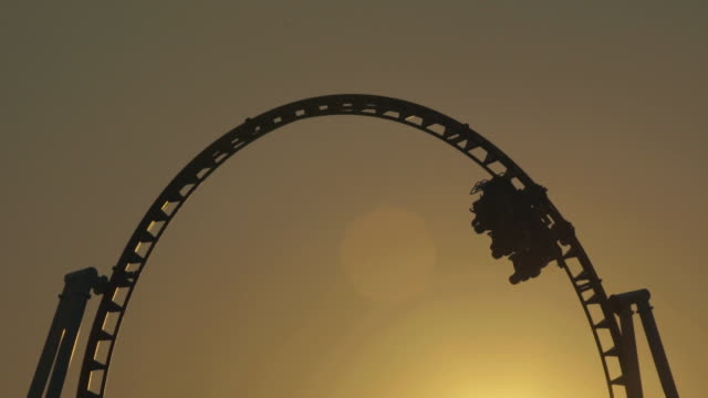 sunset roller coaster - rollercoaster stock videos & royalty-free footage