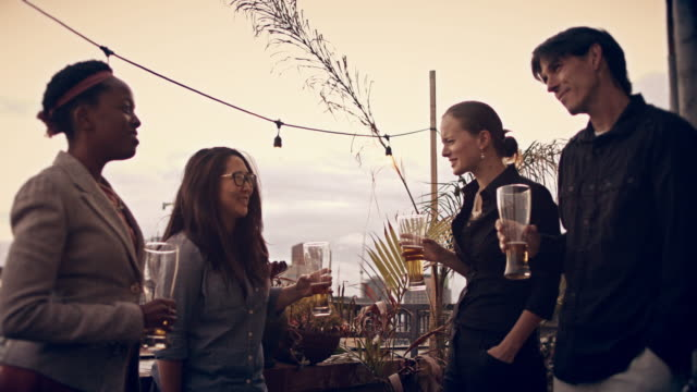 sunset rooftop party - top garment stock videos & royalty-free footage