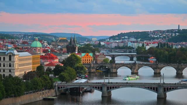 sunset scene of bridges on vltava river, prague czech republic - praga video stock e b–roll