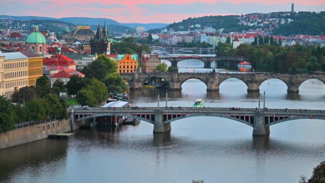 sunset scene of bridges on vltava river, prague czech republic - river vltava stock videos & royalty-free footage