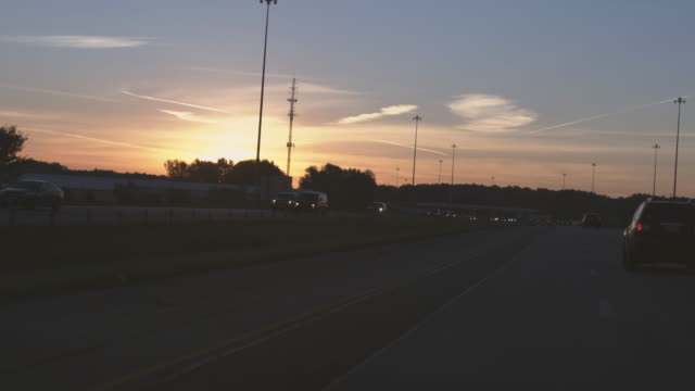 sunset scenery from moving car. - ohio stock videos & royalty-free footage