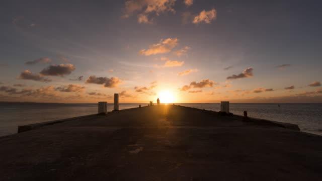 vídeos y material grabado en eventos de stock de sunset scenery of beach in saipan / saipan, northern mariana islands, united states - lugar turístico