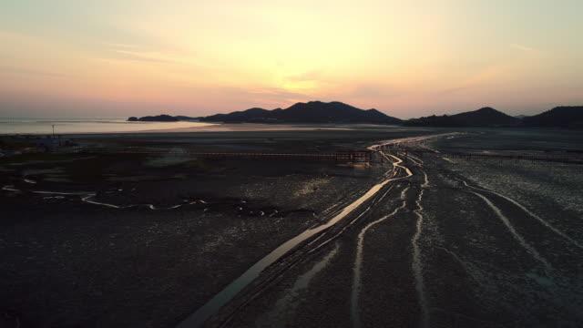 sunset scenery of mudflat in jeungdo island / sinan-gun, jeollanam-do, south korea - mud flat stock videos & royalty-free footage