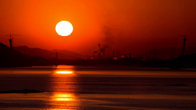 sunset scenery of namhaedaegyo bridge / namhae-gun, gyeongsangnam-do, south korea - omega sun mirage stock videos & royalty-free footage