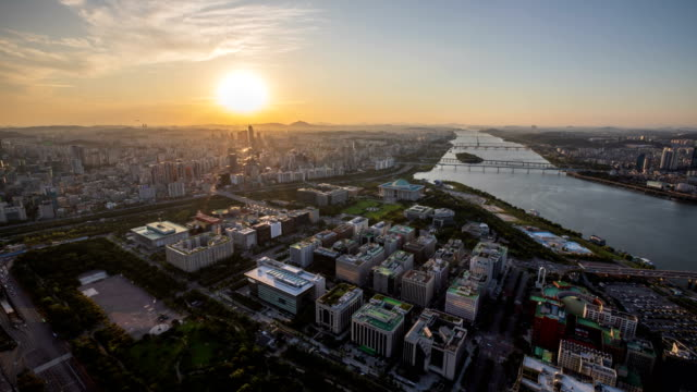 sunset scenery of national assembly building and city buildings near han river / yeouido, seoul, south korea - national assembly stock videos & royalty-free footage
