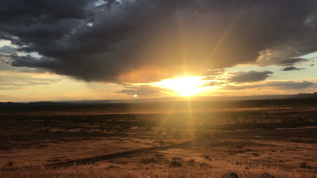 sunset scenes in western colorado outdoor high desert locations at golden hour with clouds moving in front of the sun - golden hour stock videos & royalty-free footage