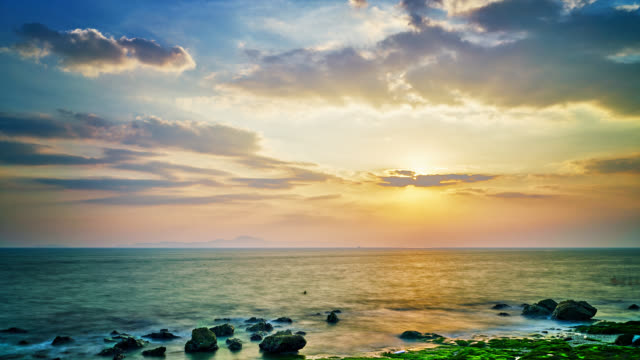 sunset. sea. beach. island. stone. relax - seascape stock videos & royalty-free footage