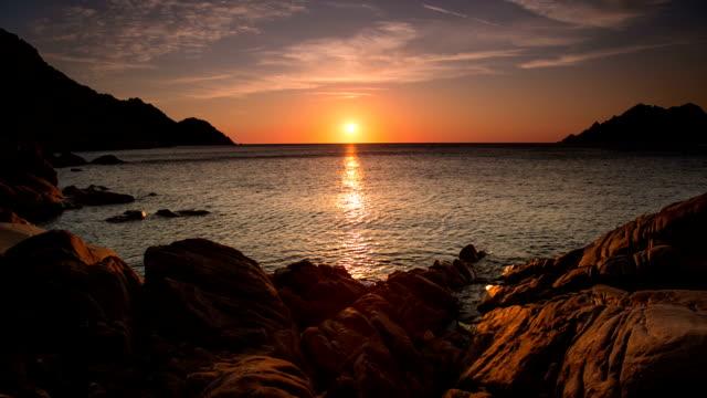 sunset sea - rocky coastline stock videos & royalty-free footage