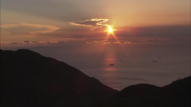 ws ha sunset seascape, hong kong, hong kong, china - seascape stock videos & royalty-free footage