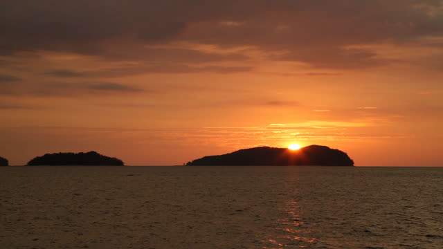 sunset seascape of kota kinabalu island - 1 minute or greater stock videos & royalty-free footage
