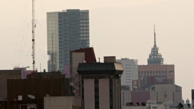 sunset shot from mexico city skyline - torre latinoamericana stock videos & royalty-free footage
