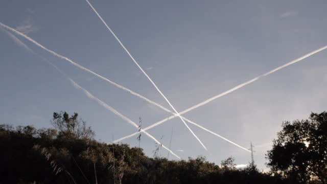 sunset shot with sky trails - vapour trail stock videos & royalty-free footage