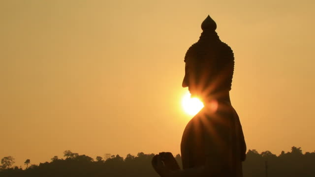 sunset side big buddha statue silhouette. - buddha stock videos and b-roll footage