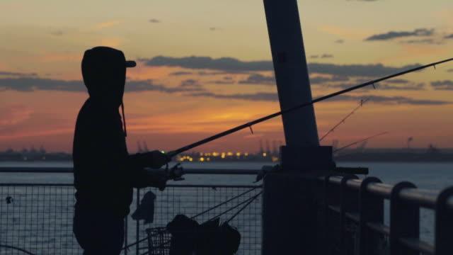 Sunset Silhouette Fishermen