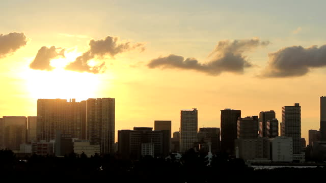 TL, WS, Sunset Silhouette over buildings and water. Tokyo, Japan