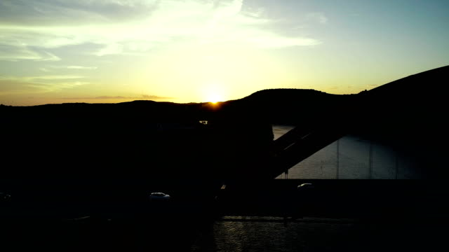 sunset silhouette side pan next to pennybacker bridge - arch bridge stock videos & royalty-free footage