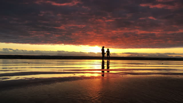 sunset silhouette sister time on the beach bonding - back lit stock videos & royalty-free footage