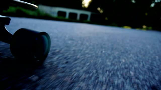 sunset skateboarding - longboard - dusk stock videos & royalty-free footage