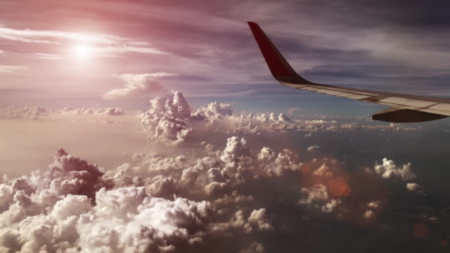 sunset sky from airplane - land stock videos & royalty-free footage