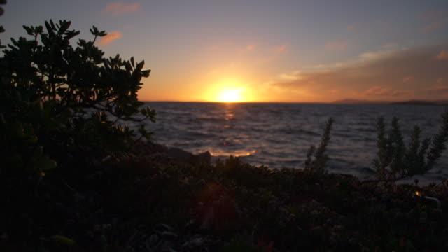 sunset sky over water  - aufblenden stock-videos und b-roll-filmmaterial