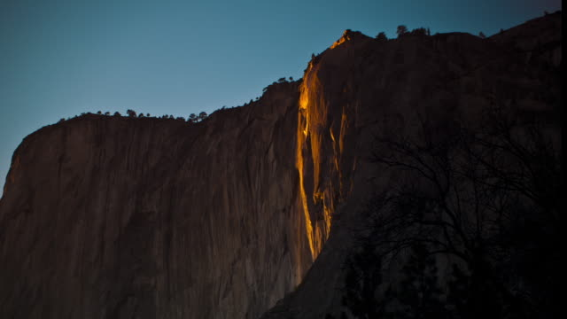 Sunset strikes Horsetail Fall on El Capitan in Yosemite National Park, California.